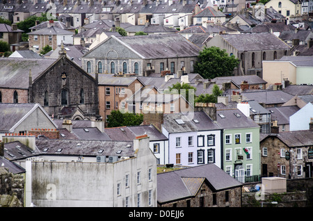 CAERNARFON, Wales - Rooftops of houses and buildings with their Welsh slate roof tiles as seen from one of the towers - Stock Photo