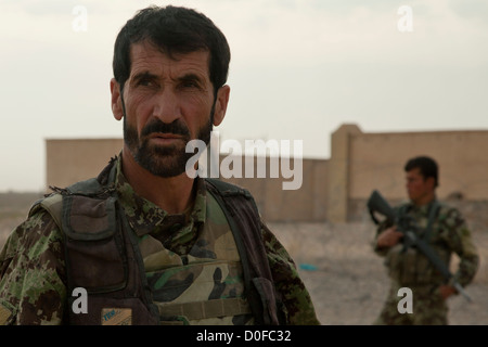 An Afghan National Army Commando maintains security during an Afghan Force led security patrol October 30, 2012 - Stock Photo