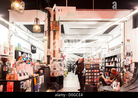 Rough Trade East Record store interior London Shoreditch. Shop in Old Truman Brewery just off Brick Lane. Man drinking - Stock Photo