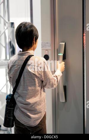 November 25, 2012, Tokyo, Japan - A kid tries the door security system. Good Design Award 2012 displays 1,180 good - Stock Photo