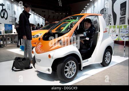 November 25, 2012, Tokyo, Japan - A men tries the electric vehicle B-Com by Toyota. Good Design Award 2012 displays - Stock Photo