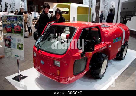 November 25, 2012, Tokyo, Japan - Visitors see the compact fire truck. Good Design Award 2012 displays 1,180 good - Stock Photo