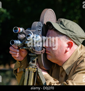 Official US War Photographer 1940's (Recreation) with Bell & Howell Military Filmo 3-lens turret movie camera & - Stock Photo