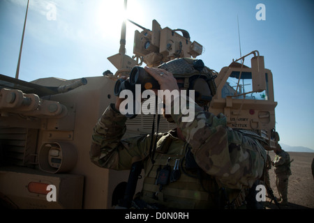 A coalition force member maintains security during village stability operations in Farah province, Afghanistan, - Stock Photo