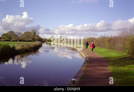 Caucasian Senior Couple Walking Along the Staffordshire & Worcestershire Canal, Nr Wombourne, Staffordshire, England, - Stock Photo