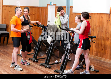 People talking after spinning class - Stock Photo