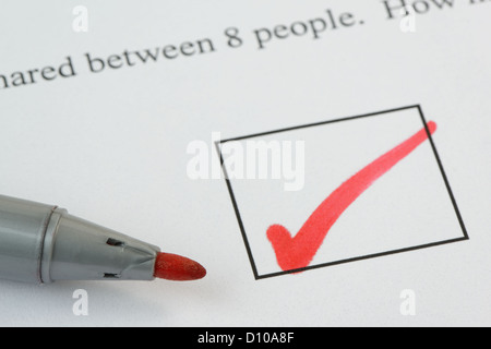 Tick mark on an exam paper, with pen. Text not subject to copyright. 36 mp image - Stock Photo