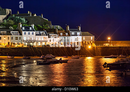Mont Orgueil Castle and Gorey harbour at night, Jersey, Channel islands, UK - Stock Photo