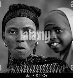 Black And White Portrait Of A Surprised Oromo Woman, Dire Dawa, Ethiopia - Stock Photo