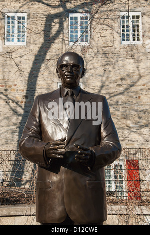 Statue Of Jean Drapeau And A Stone Building In The Background; Montreal Quebec Canada - Stock Photo