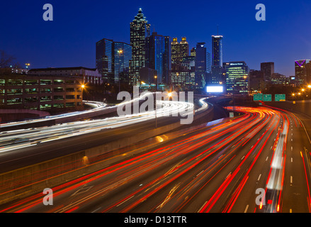 The I-85 highway and midtown Atlanta at night - Stock Photo