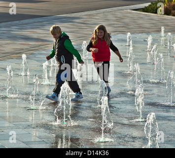 children playing in the fountains  on southend sea front - Stock Photo