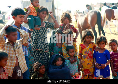 Happy Indian Children at Desert Village in Pushkar, Rajasthan, India - Stock Photo