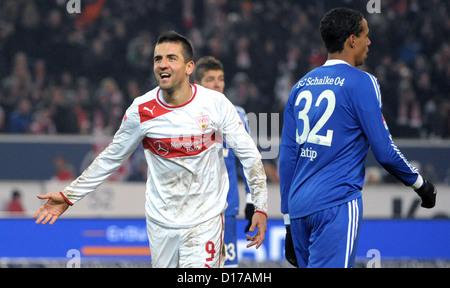 Stuttgart's Vedad Ibisevic (L) celebrates his 3-1 goal next Schalke's Joel Matip (R) during Bundesliga soccer match - Stock Photo