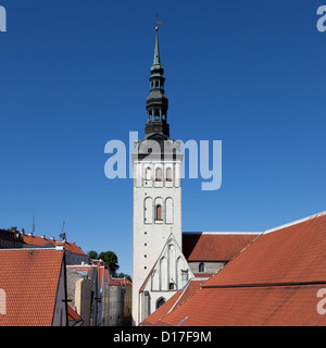 Church steeple overlooking town - Stock Photo