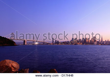 Urban skyline and bridge with river - Stock Photo