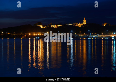 Topkapi Palace at early morning twilight with lights reflected in the Golden Horn Istanbul Turkey - Stock Photo