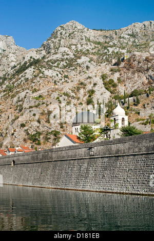 The fortified wall and Skurda River protecting the north side of the Kotor old town in Montenegro. - Stock Photo