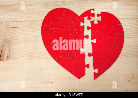 Heart shaped jigsaw puzzle - Stock Photo