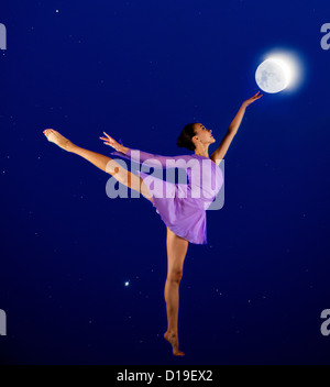 Ballerina reaching for the moon - Stock Photo