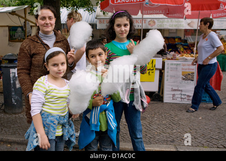 Berlin, Germany, the mother with her children with cotton candy on a street party - Stock Photo