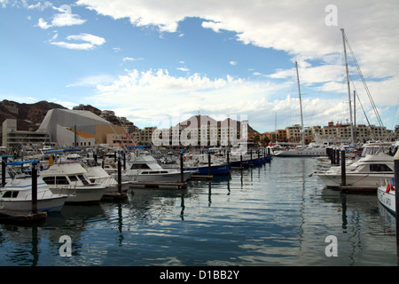Boats and yachts at Cabo San Lucas Marina with dramatic clouds - Stock Photo
