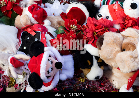 Different types of Cuddly Christmas Toys in a basket - Stock Photo