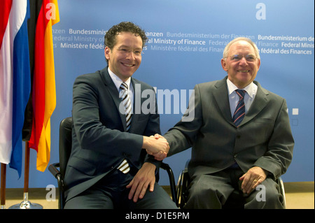 German minister of finance Wolfgang Schaeuble (r) receives his Dutch counterpart Jeroen Dijsselbloem at the ministry - Stock Photo