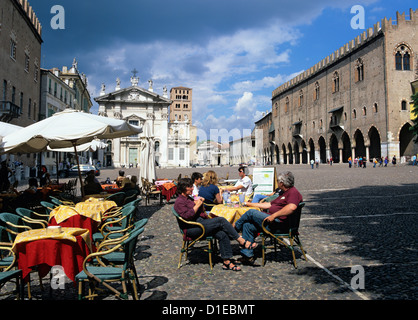 Cafe scene in the Piazza Sordello with the Palazzo Ducale and Duomo, Mantua, Lombardy, Italy, Europe - Stock Photo