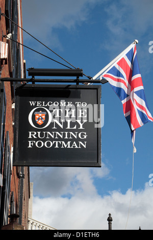 Sign above The Only Running Footman public house, 5 Charles Street, Mayfair, London, UK. - Stock Photo