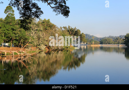 Early morning reflections on Kandy Lake in Kandy, Sri Lanka - Stock Photo