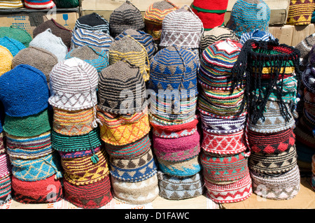 Brightly coloured knitted wool hats for sale in the souk in Marrakech, Morocco, North Africa, Africa - Stock Photo