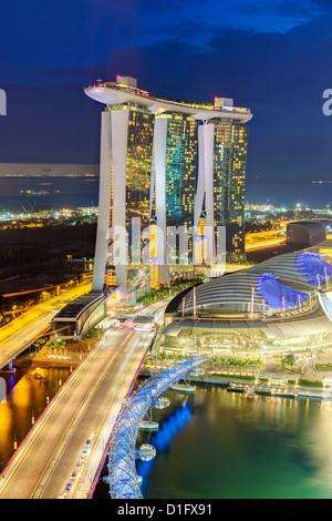 The Helix Bridge and Marina Bay Sands Singapore at night, Marina Bay, Singapore, Southeast Asia, Asia - Stock Photo