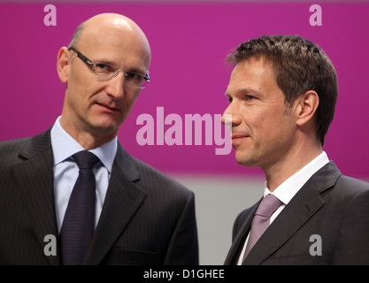 Deutsche Telekom CEO Rene Obermann (R) and CFO Timotheus Hoettges (L) talk ahead of the German telecommunication - Stock Photo