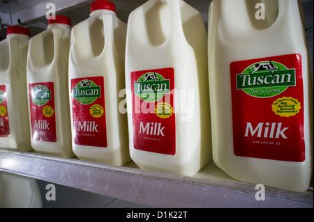 Containers of milk in a supermarket refrigerator in New York - Stock Photo