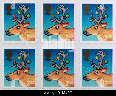 Book of 2nd Class Postage Stamps Christmas 2012 depicting a reindeer - Stock Photo
