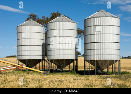 Grain silos on a farm in South-Western New South Wales, Australia - Stock Photo