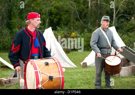 Two men dressed as US Civil War Confederate soldiers drumming at an encampment at the Virginia State Fair in Richmond - Stock Photo