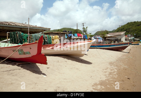 Fishing boats on the beach at Anse la Raye village, St Lucia, Caribbean, West indies - Stock Photo