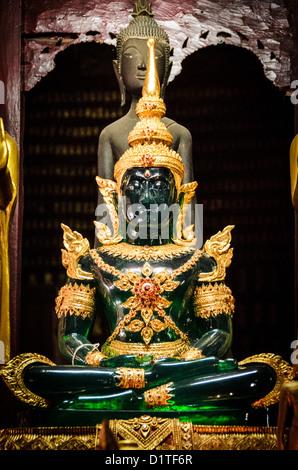 LUANG PRABANG, Laos - The famous Jade Buddha at Wat Mai Suwannaphumaham.  Wat Mai, as it is often known, is a Buddhist - Stock Photo