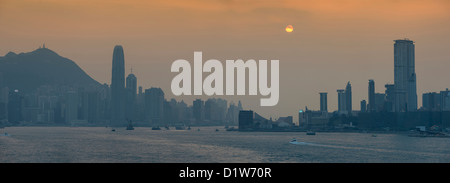 Panorama of Hong Kong Skyline and Harbour at Sunset - Stock Photo