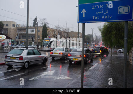 Felled trees and large puddles delay traffic and cause congestion on Herzl Boulevard, a main traffic artery in Jerusalem - Stock Photo