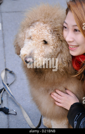 Tourist posing with Charles the Lion Dog. EDITORIAL USE ONLY. NO COMMERCIAL USES. - Stock Photo