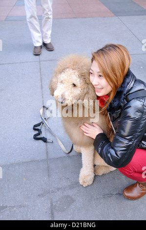 Tourist posing with Charles the Lion Dog EDITORIAL USE ONLY. NO COMMERCIAL USES. - Stock Photo