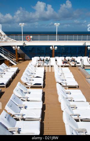 Lounge chairs on pool deck of cruise ship Azamara Journey, Azamara Club Cruises, Irish Sea, near Wales, United Kingdom - Stock Photo