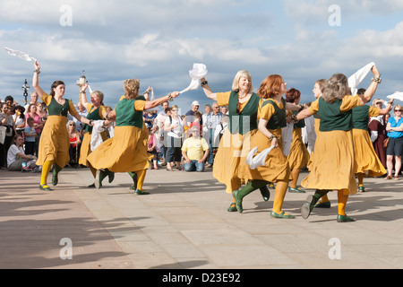 Folk dancing at the Whitby Folk Week 2012 with female morris dancers - Stock Photo
