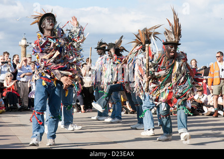 Folk dancing at the Whitby Folk Week 2012 with black faced male morris dancers - Stock Photo