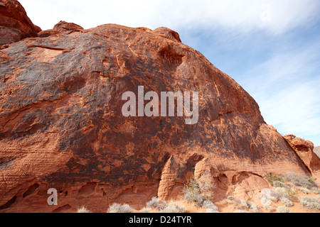 desert black varnish and petroglyphs on large sandstone rock valley of fire state park nevada usa - Stock Photo