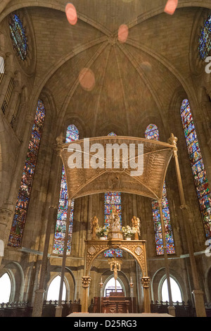 Gothic Real Colegiate de Santa Maria de Roncesvalles church, a pilgrimage church with stained glass and a gold canopy - Stock Photo