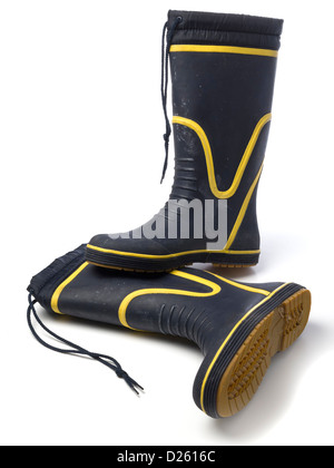 One pair of blue and yellow wellington boots isolated on white background - Stock Photo